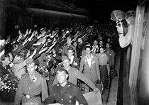 Roger-Viollet | 841534 | World War II. Departure of a contigent of volunteers for the French unity of the Waffen SS. Paris, gare de l'Est, September 1943. | © LAPI / Roger-Viollet