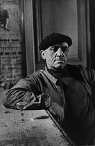 Roger-Viollet | 858438 | Along the river Deûle. Customer at the  Pont-Maudit  café. France, 1953. Photograph by Jean Marquis (1926-2019). | © Jean Marquis / Roger-Viollet