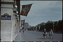 Roger-Viollet | 872040 | World War II. Swastikas fluttering in the wind in the rue de Rivoli, in front of the Tuileries and on the corner of the rue Rouget-de-Lisle, Paris, about 1942-1943. Photograph by André Zucca (1897-1973). Bibliothèque historique de la Ville de Paris. | © André Zucca / BHVP / Roger-Viollet