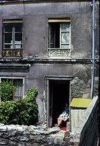 Roger-Viollet | 872681 | Woman at her doorstep, Villa de l'Ermitage, in the district of Belleville. Paris (XXth arrondissement), June 1967. Photograph by Léon Claude Vénézia (1941-2013). | © Léon Claude Vénézia / Roger-Viollet