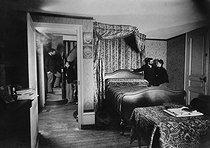 Roger-Viollet | 877377 | Bilocation in the bedroom. Special effect photograph by Henri Roger (1869-1946). | © Henri Roger / Roger-Viollet