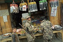 Roger-Viollet   888047   Second war in Afghanistan between the USA and the Northern Alliance against the Taliban following the September 11, 2001 attacks. Northern Alliance's Mujahideen fighters doing some shopping in the general store of the small city of Barak. Afghanistan, September-October 2001.   © Jean-Paul Guilloteau / Roger-Viollet
