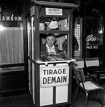 Roger-Viollet | 893255 | Ticket seller of the national lottery. Paris, 1956. | © LAPI / Roger-Viollet