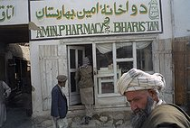 Roger-Viollet   895720   Second war in Afghanistan between the USA and the Northern Alliance against the Taliban following the September 11, 2001 attacks. Northern Alliance's Mujahideen fighters doing some shopping in the general store of the small city of Barak. Afghanistan, September-October 2001.   © Jean-Paul Guilloteau / Roger-Viollet