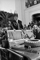 Roger-Viollet | 897837 | Habib Bourguiba ( 1903-2000 ), Tunisian statesman, arriving in a Tunisian city, 1956. | © Bernard Lipnitzki / Roger-Viollet