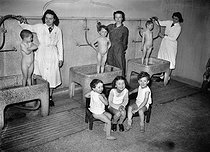 Roger-Viollet | 899051 | Showers in a school. Paris, March, 1943. | © LAPI / Roger-Viollet