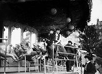 Roger-Viollet | 901917 | Young women on roundabout of wooden pigs. Paris, Fête des Invalides, 1908. | © Jacques Boyer / Roger-Viollet