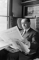 Roger-Viollet | 904994 | Pierre Mendès France (1907-1982), French politician, reading the  Combat  newspaper in a train to Brittany, during the election campaign of the Republican Front. France, 1955. Photograph by Jean Marquis (1926-2019). | © Jean Marquis / Roger-Viollet