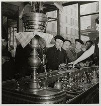 Roger-Viollet | 912805 | Men having a drink at the goatherds' café. Paris, 1937. Photograph by Roger Schall (1904-1995). Paris, musée Carnavalet. | © Roger Schall / Musée Carnavalet / Roger-Viollet