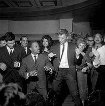 Roger-Viollet | 931647 | Harold Nicholas, Johnny Hallyday and Eddie Barclay. Paris, Club Saint-Hilaire nightclub, 1963-1965. | © Noa / Roger-Viollet