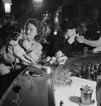 Roger-Viollet | 932004 | Young women in a bar. Paris, 1937-1938. | © Gaston Paris / Roger-Viollet