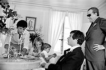 Roger-Viollet | 934348 | Christening of Anthony Delon, Alain Delon and Nathalie's son, with Jean-Claude Brialy and Luchino Visconti. on May 1st, 1966. Photograph by Georges Kelaïditès (1932-2015). | © Georges Kelaïditès / Roger-Viollet