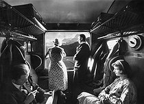 Roger-Viollet | 938432 | Swiss railway. Travellers in a 2nd class compartment. Switzerland, 1935. | © Jacques Boyer / Roger-Viollet