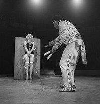 Roger-Viollet | 943335 | Circus : knife thrower. France, circa 1935. | © Gaston Paris / Roger-Viollet