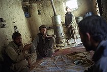 Roger-Viollet   949160   Second war in Afghanistan between the USA and the Northern Alliance against the Taliban following the September 11, 2001 attacks. Inn at the Anjoman col to the north of the Panshir Valley, welcomes the lorry drivers who transport petrol on the front line.   © Jean-Paul Guilloteau / Roger-Viollet