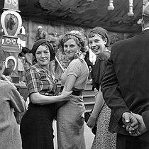 Roger-Viollet | 959452 | Women at a fun fair. France, circa 1935. | © Gaston Paris / Roger-Viollet