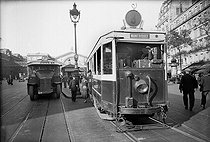 Roger-Viollet   963775   Bus and tramway station in front of the Est station. Paris, 1936.   © Albert Harlingue / Roger-Viollet