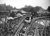 Roger-Viollet | 964251 | World War II. The scenic-railway at the Foire du Trône. Paris, June, 1941. | © LAPI / Roger-Viollet