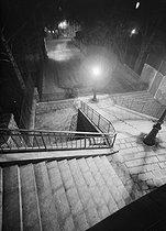 Roger-Viollet | 985546 | Montmartre. Stairs, rue de la Bonne, at night. Paris (XVIIIth arrondissement), 1948. Photograph by René Giton (known as René-Jacques, 1908-2003). Bibliothèque historique de la Ville de Paris. | © René-Jacques / BHVP / Roger-Viollet