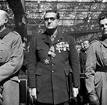 Roger-Viollet | 1032532 | World War II. Jacques Doriot (1898-1945) at a demonstration of the Legion of the French Volunteers at the Winter Velodrome. Paris, April 1944. | © LAPI / Roger-Viollet