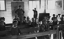 Roger-Viollet | 1035383 | School built by the soldiers for the children of the village of M'Zaourat, Mascara Area, during the Algerian War of Independence. Algeria, Summer 1961. | © Jean-Pierre Laffont / Roger-Viollet