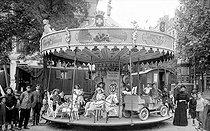 Roger-Viollet | 1047659 | Merry-go-round. France, around 1910. | © Roger-Viollet / Roger-Viollet