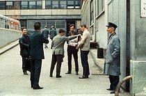 Roger-Viollet | 1050644 | May-June 1968 events. Sale of copies of  La Vie Ouvrière , official weekly newspaper of the CGT union (Confédération Générale du travail, General Confederation of Labour), at the Citroën car factory. Paris, May 1968. Photograph by Georges Azenstarck (born in 1934). | © Georges Azenstarck / Roger-Viollet
