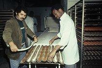 Roger-Viollet | 1052854 | Migrant workers at the Hédé industrial bakery. Ivry-sur-Seine (Val-de-Marne), 1983. | © Georges Azenstarck / Roger-Viollet