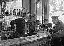 Roger-Viollet   1053095   Café owner talking to his customers, at the corner of the rue de Varenne and the boulevard des Invalides. Paris (VIIth arrondissement), 1942. Photograph by René Giton (known as René-Jacques, 1908-2003). Bibliothèque historique de la Ville de Paris.   © René-Jacques / BHVP / Roger-Viollet