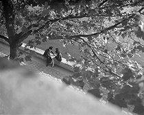 Roger-Viollet   1061883   Lovers on the banks of the river Seine. Paris, 1945. Photograph by René Giton known as René-Jacques (1908-2003). Bibliothèque historique de la Ville de Paris.   © René-Jacques / BHVP / Roger-Viollet
