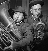 Roger-Viollet | 1070741 | Musicians from a circus. France, circa 1935. | © Gaston Paris / Roger-Viollet