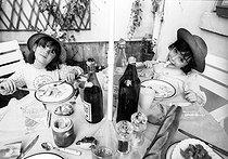 Roger-Viollet | 1079077 | Little girls eating. France, 1970's. | © Jean-Pierre Couderc / Roger-Viollet