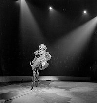 Roger-Viollet | 1080493 | Circus : clown riding a bicycle. France, circa 1935. | © Gaston Paris / Roger-Viollet