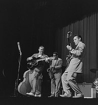 Roger-Viollet | 1091317 | Bill Haley (1925-1981), American guitarist, singer and rock and roll conductor, with his group, the  Comets . Paris, Olympia, in October 1958. | © Studio Lipnitzki / Roger-Viollet
