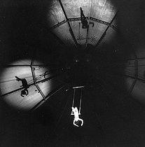 Roger-Viollet | 1105698 | Circus : trapeze artist. France, circa 1935. | © Gaston Paris / Roger-Viollet