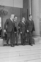 Roger-Viollet | 1108900 | Events of May-June 1968. Meeting of the Council of Ministers. Henri Duvillard (1910-2001), Minister for War Veterans, Edmond Michelet (1899-1970), State Minister, and Robert Boulin (1920-1979), Minister for the Public Service, leaving Matignon. Paris (VIth arrondissement), on June 12, 1968. Photograph by Jean Laborie, from the collections of the French newspaper  France-Soir . Bibliothèque historique de la Ville de Paris. | © Jean Laborie / Fonds France-Soir / BHVP / Roger-Viollet