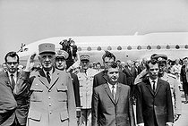 Roger-Viollet | 1129159 | Events of May-June 1968. General Charles de Gaulle (1890-1970), President of the French Republic, during an official visit in Romania, greeted by Nicolae Ceausescu (1918-1989), Romanian statesman. Bucarest (Romania), Baneasa airfield on May 14, 1968. Photograph by Bernard Charlet, from the collections of the French newspaper  France-Soir . Bibliothèque historique de la Ville de Paris. | © Bernard Charlet / Fonds France-Soir / BHVP / Roger-Viollet