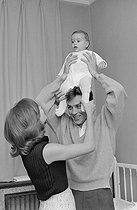 Roger-Viollet | 1282530 | Nathalie Delon (born in 1941) and Alain Delon (born in 1935) playing with their son Anthony Delon (born in 1964). France, on April 28, 1965. Photograph by Jean Laborie (1928-2014), from the collections of the newspaper  France Soir . Bibliothèque historique de la Ville de Paris. | © Jean Laborie / Fonds France-Soir / BHVP / Roger-Viollet