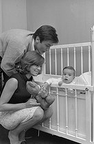 Roger-Viollet | 1283188 | Nathalie Delon (born in 1941) and Alain Delon (born in 1935) playing with their son Anthony Delon (born in 1964). France, on April 28, 1965. Photograph by Jean Laborie (1928-2014), from the collections of the newspaper  France Soir . Bibliothèque historique de la Ville de Paris. | © Jean Laborie / Fonds France-Soir / BHVP / Roger-Viollet