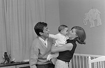 Roger-Viollet | 1283333 | Nathalie Delon (born in 1941) and Alain Delon (born in 1935) playing with their son Anthony Delon (born in 1964). France, on April 28, 1965. Photograph by Jean Laborie (1928-2014), from the collections of the newspaper  France Soir . Bibliothèque historique de la Ville de Paris. | © Jean Laborie / Fonds France-Soir / BHVP / Roger-Viollet