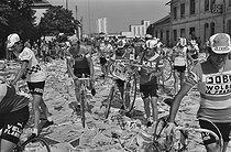 Roger-Viollet | 1352803 | Tour de France 1976. Protest from the workers of the Lip clock factory based in Besançon, during the 7th stage from Nancy to Mulhouse, on July 1st, 1976. Photograph by Bernard Charlet, from the collections of the French newspaper  France-Soir . Bibliothèque historique de la Ville de Paris. | © Bernard Charlet / Fonds France-Soir / BHVP / Roger-Viollet