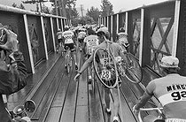 Roger-Viollet | 1353696 | Tour de France 1976. Crossing of a bridge during the 11th stage from Montgenèvre to Manosque (France), on July 6, 1976. Photograph by Bernard Charlet, from the collections of the French newspaper  France-Soir . Bibliothèque historique de la Ville de Paris. | © Bernard Charlet / Fonds France-Soir / BHVP / Roger-Viollet