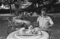 Roger-Viollet   1353795   Tour de France 1976. Raymond Poulidor (1936-2019) and Bernard Thévenet (born in 1948), French racing cyclists, during a rest day. Divonne-les-Bains (France), on July 3rd, 1976. Photograph by Bernard Charlet from the collections of the French newspaper  France-Soir . Bibliothèque historique de la Ville de Paris.   © Bernard Charlet / Fonds France-Soir / BHVP / Roger-Viollet