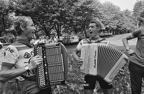 Roger-Viollet | 1354155 | Tour de France 1976. Lucien Van Impe (born in 1946), Belgian racing cyclist, on the right, playing accordion during his rest day. France, on July 2nd, 1976. Photograph by Bernard Charlet, from the collections of the French newspaper  France-Soir . Bibliothèque historique de la Ville de Paris. | © Bernard Charlet / Fonds France-Soir / BHVP / Roger-Viollet