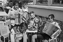 Roger-Viollet | 1357729 | Tour de France 1985. Bernard Hinault (born in 1954), French racing cyclist, playing the accordion on his rest day, on July 12, 1985. Photograph by Bernard Charlet, from the collections of the French newspaper  France-Soir . Bibliothèque historique de la Ville de Paris. | © Bernard Charlet / Fonds France-Soir / BHVP / Roger-Viollet