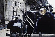 Roger-Viollet | 1372359 | Belleville district. Citroën car with a front-wheel drive, sealed buildings and graffiti. Paris (XIXth-XXth arrondissements), 1968-1975. Photograph by François-Xavier Bouchart (1946-1993). Paris, musée Carnavalet. | © François-Xavier Bouchart / Musée Carnavalet / Roger-Viollet