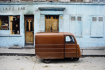 Roger-Viollet | 1372398 | Belleville district. Front view of a café-bar and three-wheeled delivery vehicle. Paris (XIXth-XXth arrondissements), 1968-1975. Photograph by François-Xavier Bouchart (1946-1993). Paris, musée Carnavalet. | © François-Xavier Bouchart / Musée Carnavalet / Roger-Viollet