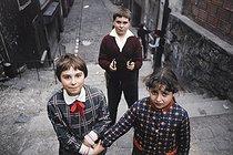 Roger-Viollet | 1372420 | Belleville district. Children in a stairway from the rue Vilin to the rue des Couronnes. Paris (XXth arrondissement), 1968-1975. Photograph by François-Xavier Bouchart (1946-1993). Paris, musée Carnavalet. | © François-Xavier Bouchart / Musée Carnavalet / Roger-Viollet