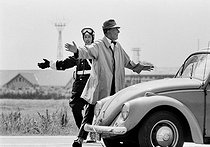 Roger-Viollet | 1375914 | Jacques Tati (1907-1982), French film-maker, actor and cult scriptwriter of French cinéma. Shooting of the film  Trafic  released in 1971. Amsterdam (Netherlands), 9 July 1970. Photograh by André Perlstein (born in 1942). | © André Perlstein / Roger-Viollet