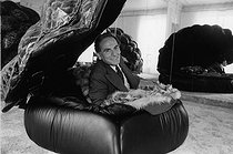 Roger-Viollet | 1376089 | Pierre Cardin (born in 1942), Italian-born French fashion designer and businessman, at the head office of his company, rue du Faubourg Saint-Honoré. Paris (VIIIth arrondissement), 2 July 1977. Photograph by André Perlstein (born in 1942). | © André Perlstein / Roger-Viollet